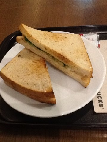 A picture containing table, food, sandwich, plate  Description automatically generated